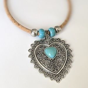 Heart shaped silver pendant with cork necklace